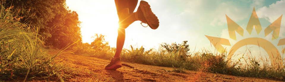 An image of an adult torso and legs running cross-country with glowing sunshine in the background.