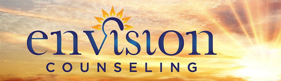 The logo of Envision Counseling on a sunset background.